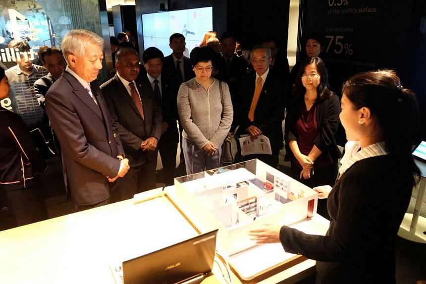 (From left) Deputy Prime Minister Teo Chee Hean, President-Designate of Nanyang Technological University (NTU) Professor Subra Suresh and Permanent Secretary (Public Service Division) Yong Ying-I, looking at the smart home sensors predictive AI for t