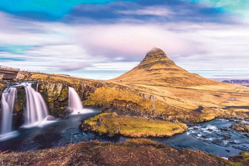 Watch the Northern Lights in Iceland's Kirkjufell Mountain.