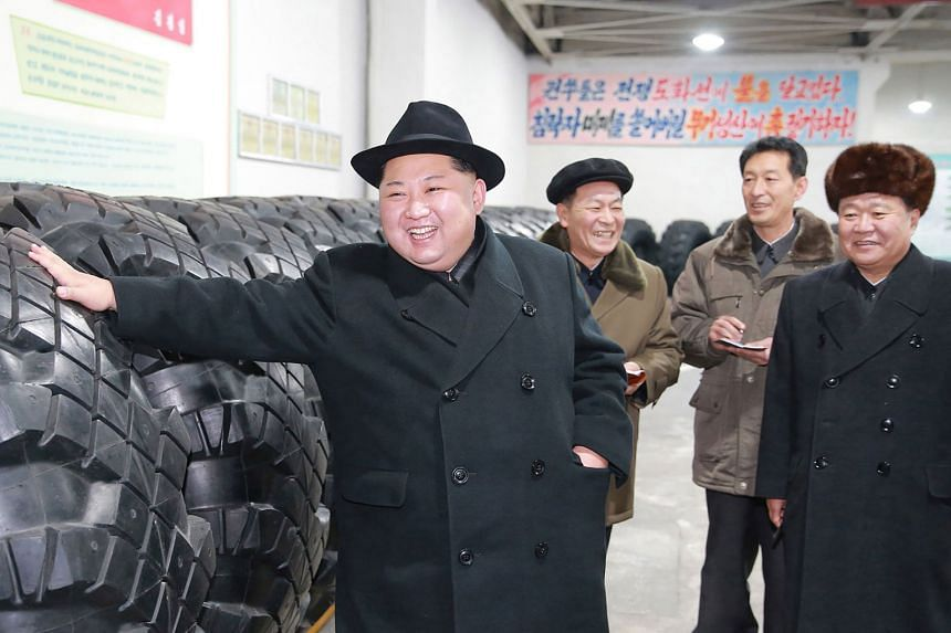 "North Korean leader Kim Jong Un on a visit to a tyre factory, a supplier of goods for mobile rocket launchers, last week. The visit came days after the North said it had completed its ""nuclear force"" with the development of the Hwasong-15 ICBM th"