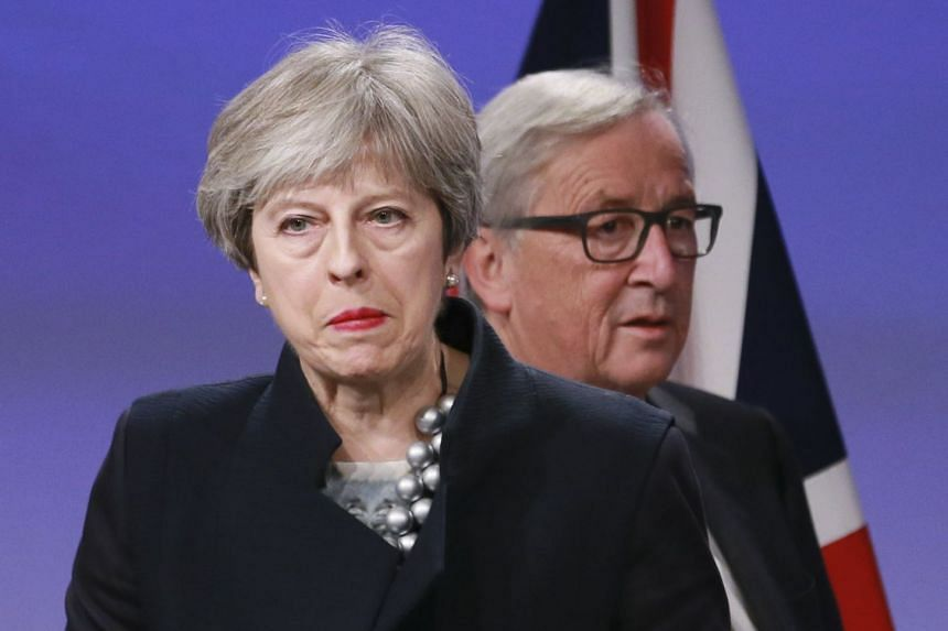 British Prime Minister Theresa May (left) and EU Commissioner President Jean-Claude Juncker prepare to give a press briefing after a meeting at the EU Commission in Brussels, Belgium, on Dec 4, 2017.
