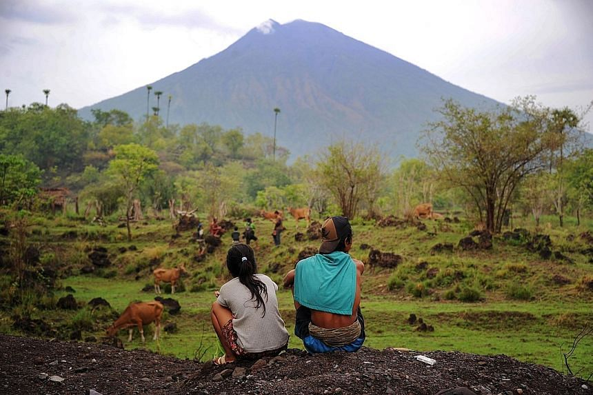 Mount Agung as seen on Sunday from Kubu sub-district in Karangasem Regency. The Volcanology and Geological Hazards Mitigation Centre says it still detects a high level of activity in the volcano.