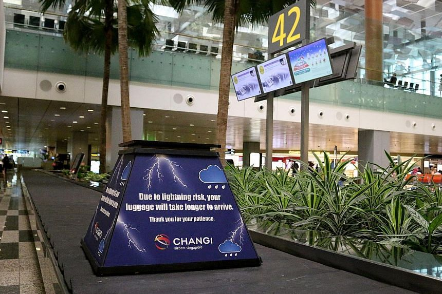 """During rainy weather, ground handlers may temporarily stop retrieving baggage from the aircraft because there is no shelter where they work and it is a lightning-risk area. """"Lightning cubes"""" with a message seeking passengers' understanding will be pl"""
