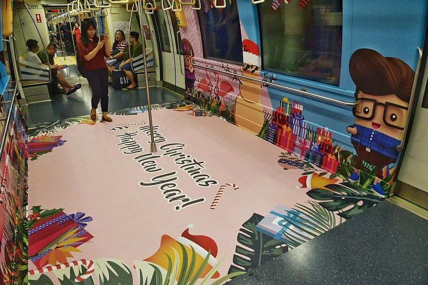 "Three MRT trains on the Downtown, North-East, and North-South/East-West lines have been decorated for Christmas, and feature the Land Transport Authority's graciousness mascots. The trains, which sport a ""Tropical Christmas"" theme, were launched yest"