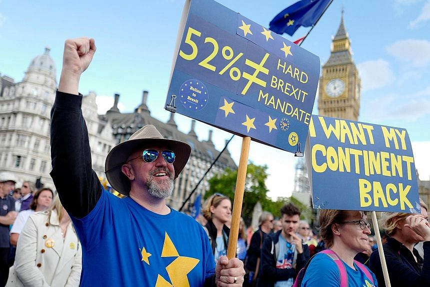Protesters lobbying outside Parliament in London to guarantee the rights of EU citizens living in Britain, after Brexit. Irish border communities making their anti-Brexit feelings clear. The border issue is the last hurdle before Brexit trade talks c