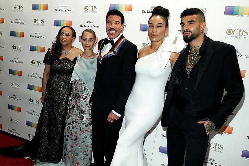 Singer Lionel Richie (centre), with his family, was one of the honourees at the Kennedy Center Honours.