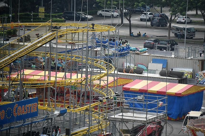 Workers testing out a roller-coaster ride at the Prudential Marina Bay Carnival ahead of its opening on Friday. The carnival, at The Promontory and Bayfront Event Space, is set to be Singapore's largest, with over 40 rides and games, many of which ha