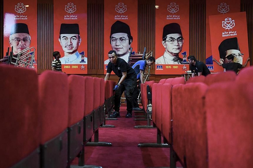 Workers preparing for the Umno general assembly starting today at the Putra World Trade Centre. Malaysian PM Najib Razak is expected to focus his energy at the meeting on readying his party for the next general election.