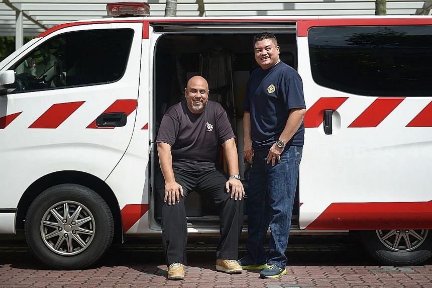 Emergency responders Syed Abdillah Alhabshee (left) and Mohamad Fuad Abdul Aziz reacted quickly when they saw a taxi engulfed in flames.