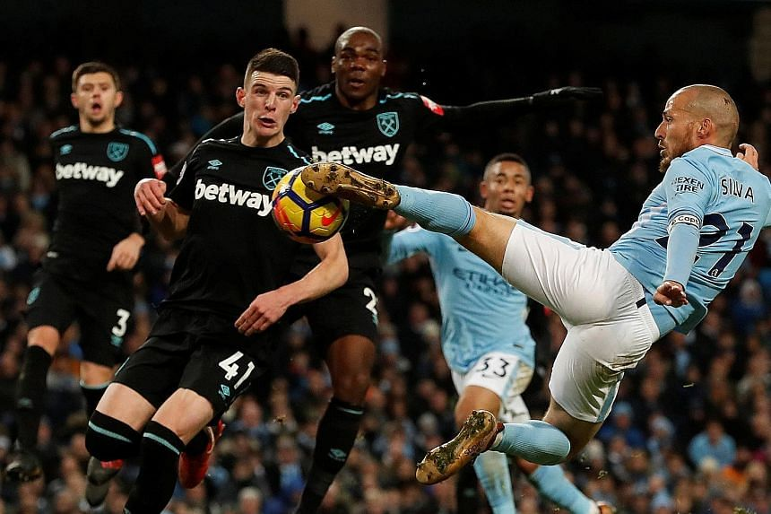 Manchester City's David Silva scoring his team's winner in the 83rd minute of the Premier League match against West Ham on Sunday to win 2-1. City are proving that every cloud has a Silva lining recently, with Raheem Sterling also coming to their res
