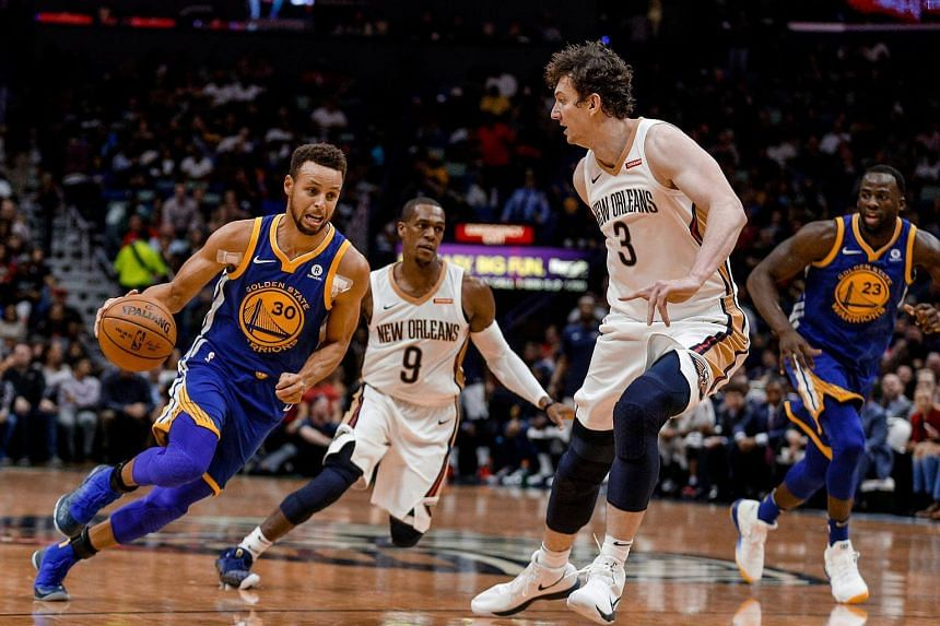 Stephen Curry (left) rolled badly on his right ankle in the final minute of the Warriors 125-115 win in New Orleans, limping off the court and later leaving the Smoothie King Center on crutches.