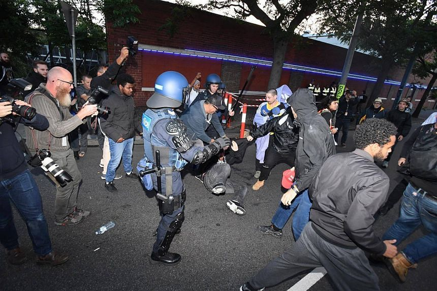 Protesters clash with Victorian Police on the sidelines of an event attended by British right wing political pundit Milo Yiannopoulos, in Kensington, Melbourne, Australia, on Dec 4.