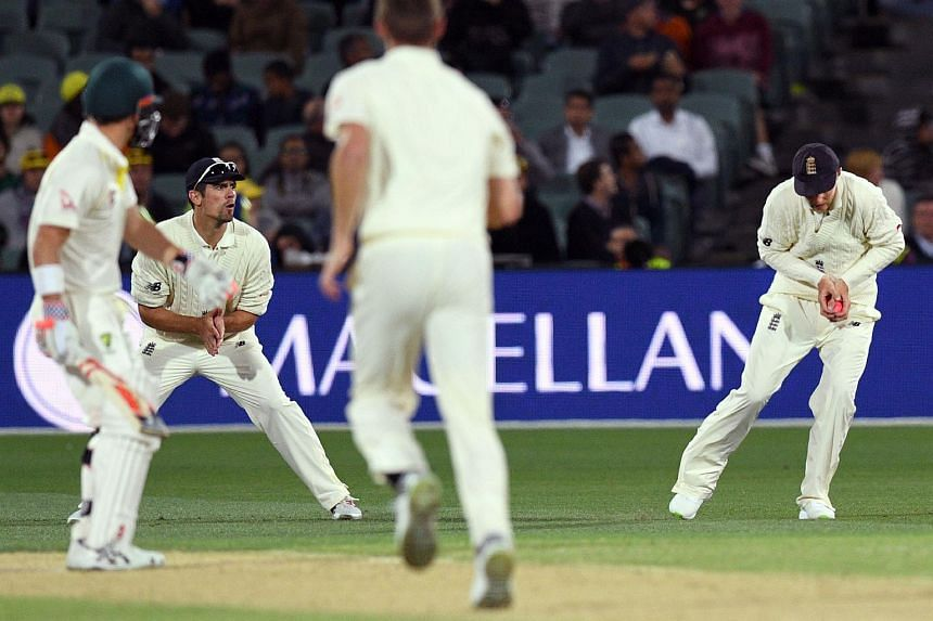 England's captain Joe Root (right) takes a catch to dismiss Australia's batsman David Warner (left) on the third day of the second Ashes cricket Test match in Adelaide in Dec 4, 2017.