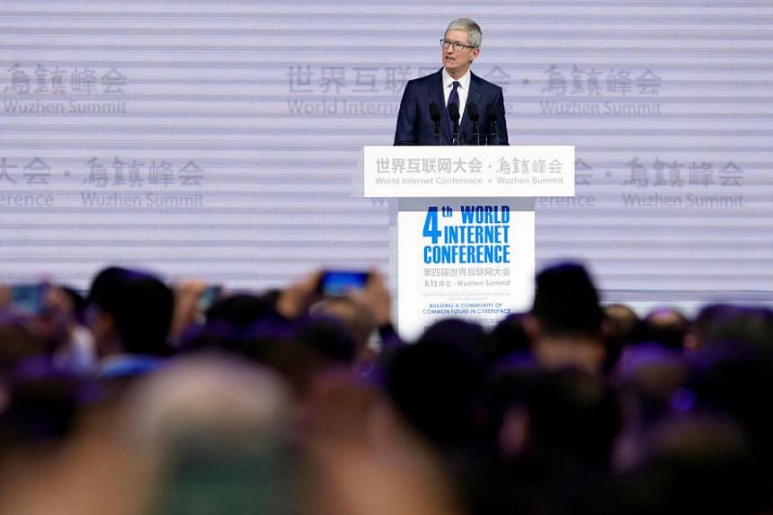 Apple chief executive Tim Cook attends the opening ceremony of the fourth World Internet Conference in Wuzhen, China on Dec 3, 2017.