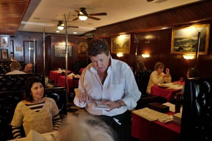 Maureen Donohue-Peters, a waitress at Donohue's Steak House, works in the restaurant in New York on May 14, 2014.