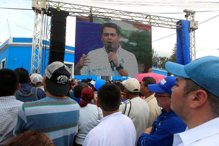 Honduran President Juan Orlando Hernandez, and candidate in November's presidential election for the ruling Partido Nacional (National Party), at his first campaign rally, in Tegucigalpa, Honduras on June 25, 2017.