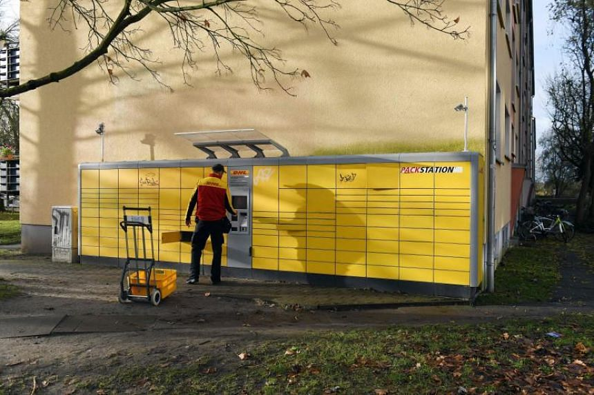 An employee of German delivery service DHL works on Dec 4, 2017 at the parcel packing station (Packstation) in Potsdam, northeastern Germany, from where a suspicious package was sent days before.