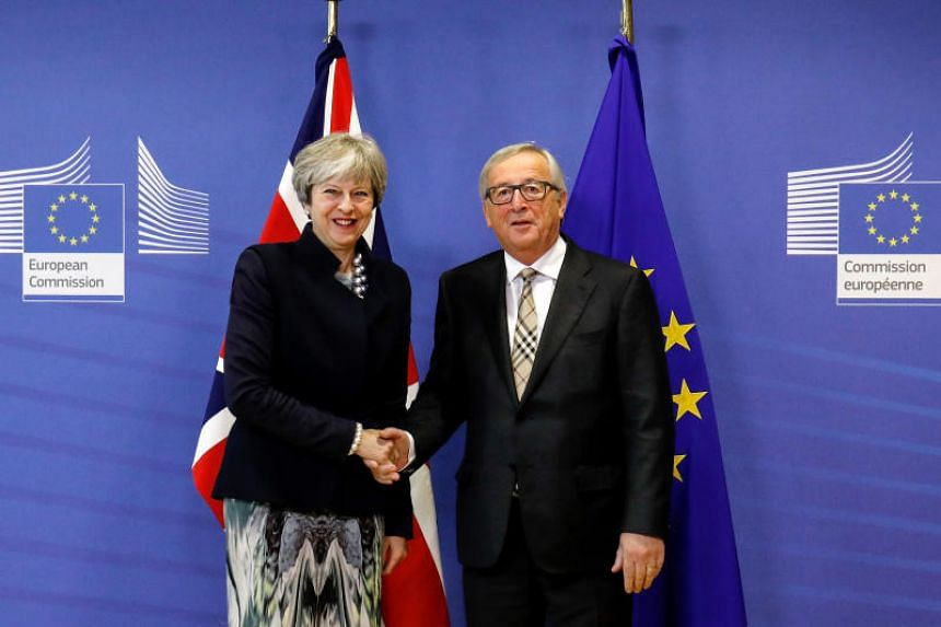 British prime minister Theresa May (left) and president of the European Commission, Jean-Claude Juncker, before a meeting at the European Commission building in Brussels, Belgium, on Dec 4, 2017.