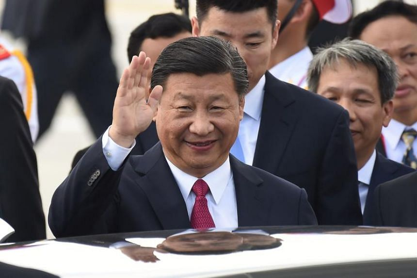 China's President Xi Jinping arrives at the international airport ahead of the Asia-Pacific Economic Cooperation (APEC) Summit in the central Vietnamese city of Danang on Nov 10, 2017.