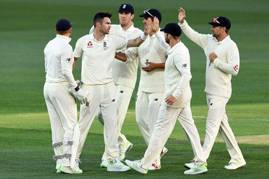 England's paceman James Anderson (second, left) celebrates dismissing Australia's batsman Cameron Bancroft with teammates on the third day of the second Ashes cricket Test match in Adelaide, on Dec 4, 2017.