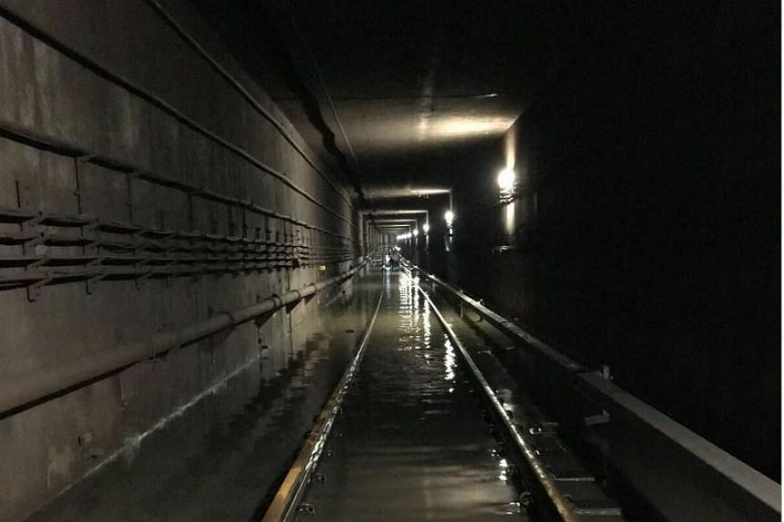 Officers from SCDF, PUB, LTA and SMRT worked through the night Oct 7 to clear the water in the tunnel between Bishan and Braddell stations.