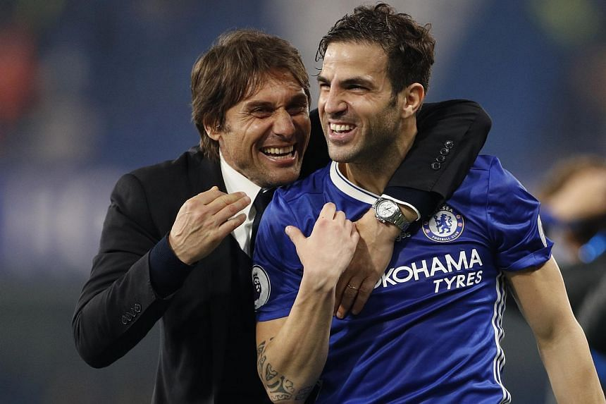 Antonio Conte celebrates after the match with Cesc Fabregas, on May 16.