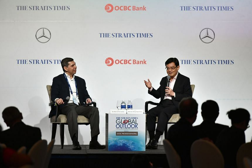 Finance Minister Heng Swee Keat (right) and ST editor Warren Fernandez at the ST Global Outlook Forum at the Ritz-Carlton on Dec 5, 2017. Mr Heng said government spending must remain sustainable even as needs grow.