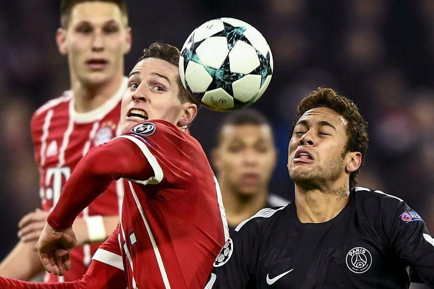 PSG's Neymar (right) in action against Bayern's Sebastian Rudy (left).