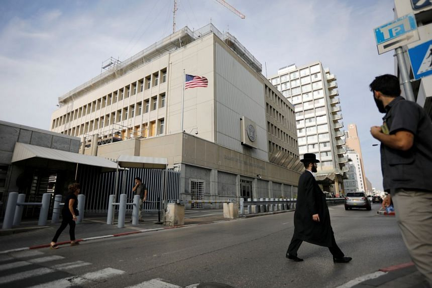 People and security can be seen outside the US Embassy in Tel Aviv, Israel, Dec 5, 2017.