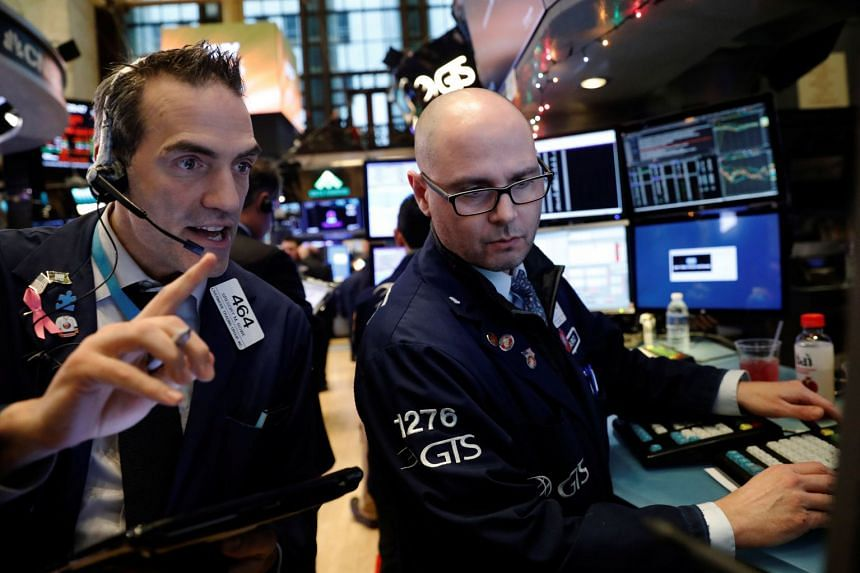 Traders work on the floor of the New York Stock Exchange shortly after the opening bell, Dec 5, 2017.