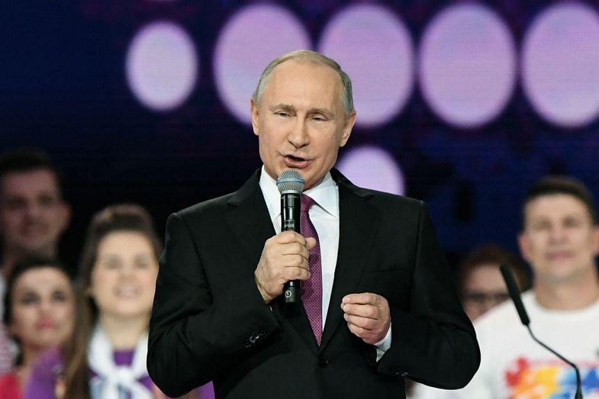 Russian President Vladimir Putin gives a speech at a forum of volunteers in Moscow, on Dec 6, 2017.