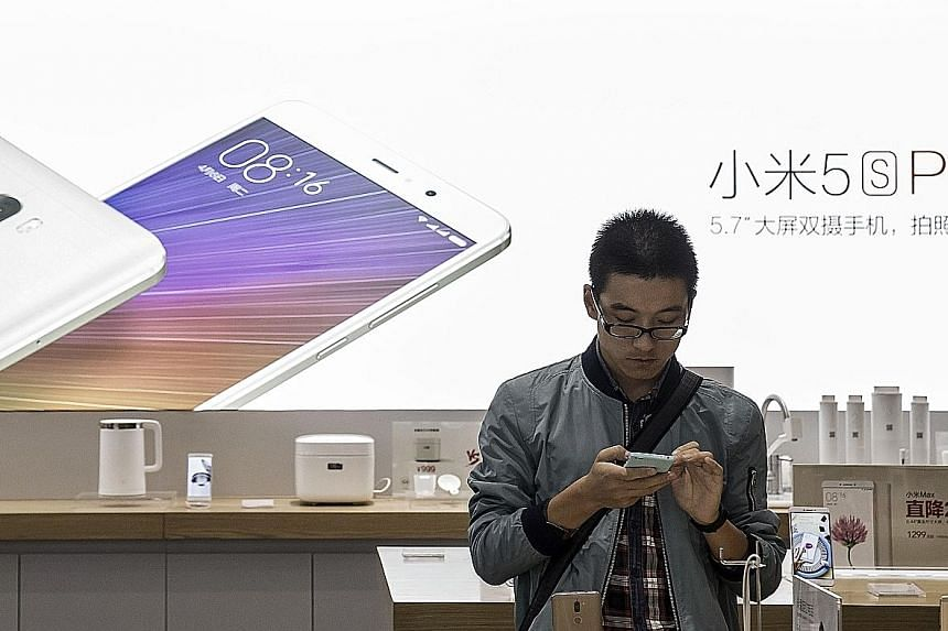 A Xiaomi store in Beijing. The smartphone maker is making a major push into old-fashioned retail, with plans to build 1,000 Mi Home stores by 2019.