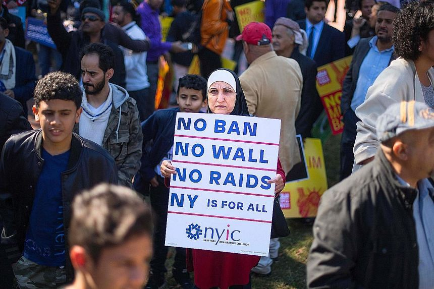 A demonstrator in Washington during a #NoMuslimBanEver rally and march in October. The US Supreme Court on Monday allowed to take effect President Donald Trump's latest travel ban targeting people from Chad, Iran, Libya, Somalia, Syria and Yemen.