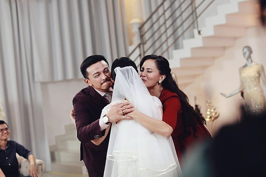Daphne Iking and Jovian Mandagie host Say Yes To The Dress Asia, the Asian version of the popular American reality television series.