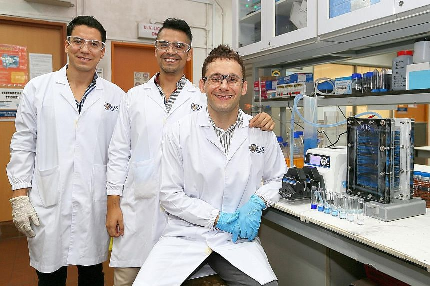 From far left: Research fellows Orlando Gracia Rodriguez and Hugo Olvera Vargas with Assistant Professor Olivier Lefebvre at the Centre for Water Research at NUS.