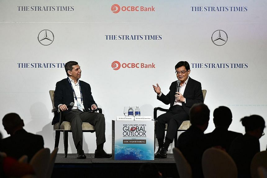 Finance Minister Heng Swee Keat speaking yesterday at The Straits Times Global Outlook Forum, with moderator Warren Fernandez, editor of The Straits Times and editor-in-chief of Singapore Press Holdings' English/Malay/Tamil Media Group.