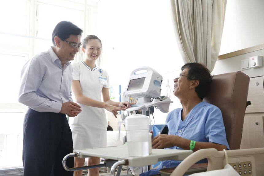 """Finance Minister Heng Swee Keat said he predicts that by 2020, government spending on healthcare will go up by """"at least $3 billion""""."""