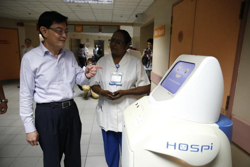 """Finance Minister Heng Swee Keat said he predicts that by 2020, government spending on healthcare will go up by """"at least $3 billion"""" a year."""