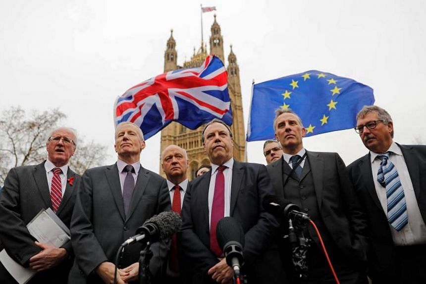 Democratic Unionist Party deputy leader Nigel Dodds (centre) speaking to the media on Dec 5, 2017, after his party rejected a Brexit deal by British PM Theresa May.