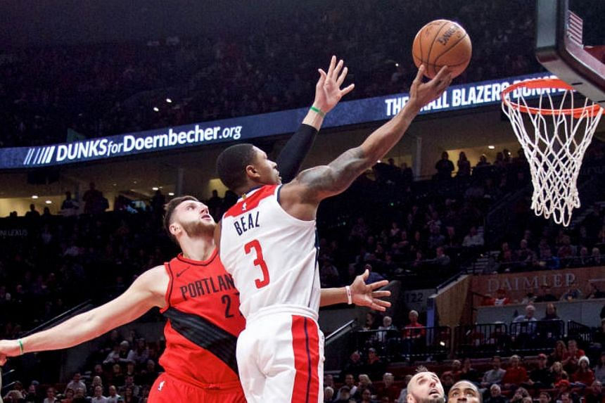 Washington Wizards guard Bradley Beal (#3) going for a layup against Portland Trail Blazers centre Jusuf Nurkic during their NBA match on Dec 5, 2017.