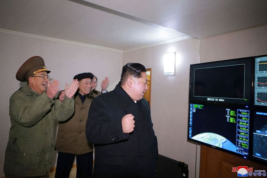 North Korean leader Kim Jong Un celebrating the launch of the Hwasong-15 ICBM, on Nov 29, 2017. South Korea has earmarked additional funds for a special warfare unit that is targeting the North Korean leader for assassination.