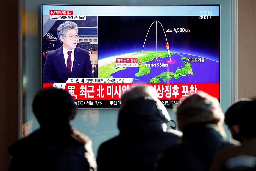People watching a news report on the flight path of the missile that was test-fired by North Korea, in Seoul on Nov 29, 2017.