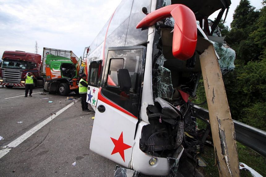 A spokesman for the Fire and Rescue Department said a double-decker bus is believed to have rammed into the back of a trailer transporting paper.