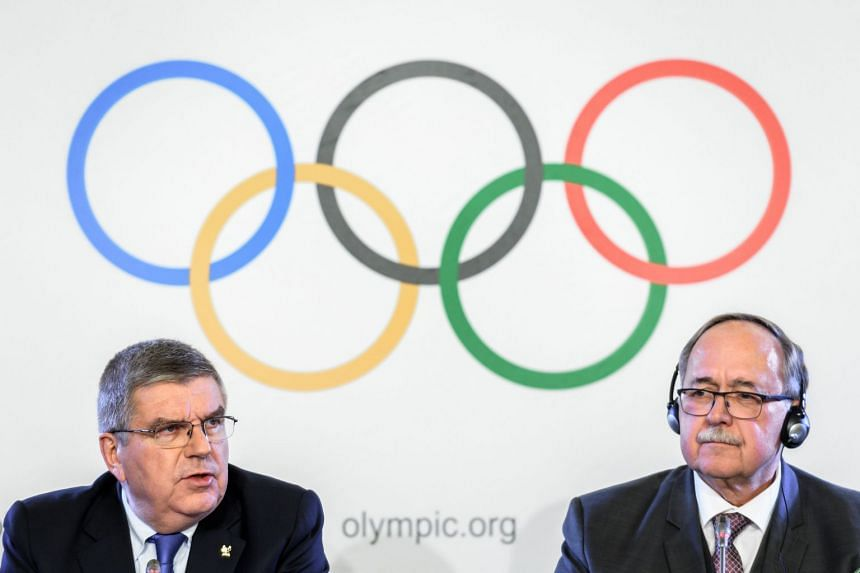 IOC president Thomas Bach (left) and report author Samuel Schmid at the press conference, Dec 5, 2017.