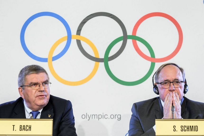 International Olympic Committee President Thomas Bach (left) and Chair of IOC Inquiry Commission into alleged Russian doping at Sochi 2014 Swiss Samuel Schmid attend a press conference following an executive meeting on Russian doping, on Dec 5, 201