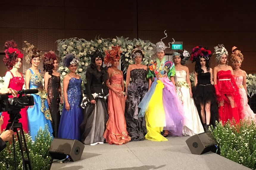 A fashion show with models wearing Makeover Magic costumes.