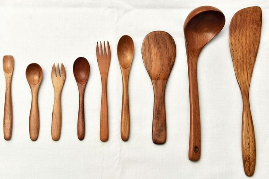 Spoons and forks that go from child- to adult-sized, all made of maple; a chestnut rice scoop; a beech ladle; and a chestnut spatula.