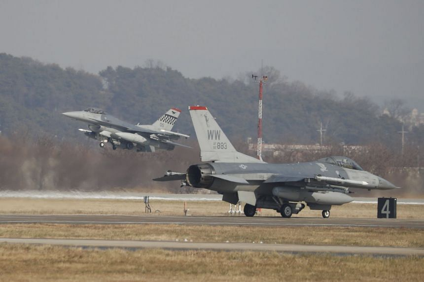US Air Force F-16 fighter jets take part in a joint aerial drill called 'Vigilant Ace' between the US and South Korea, at the Osan Air Base in Pyeongtaek, South Korea