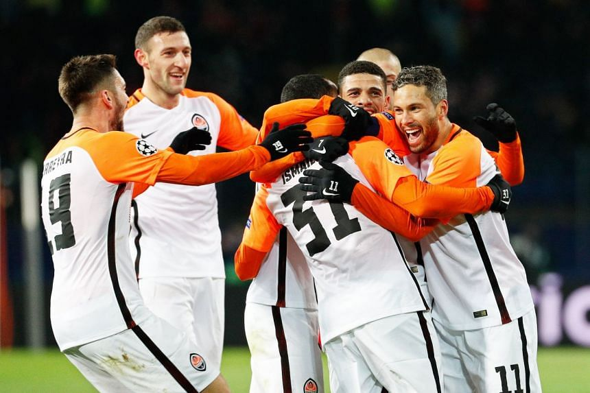 Ismaily (centre) of Shakhtar celebrates with his team mates after scoring the 2-0 lead.