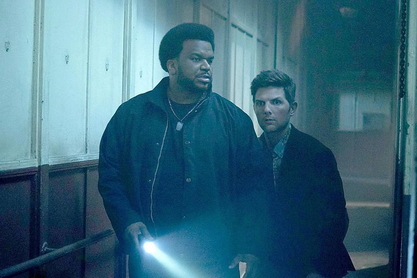 Actors Craig Robinson (left) and Adam Scott in Ghosted.