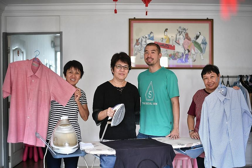 Mr Darren Wong, founder and managing director of The Social Iron, with (from left) Madam Hoh Hook Song, Mrs Agnes Tan and Mrs Violet Tan, who provide ironing services for a fee.